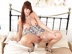 Scottish milf Toni Lace stuffs her fanny full with knickers