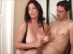 Gorgeous Mom with Big Tits Gives Hot Handjob to her Stepson