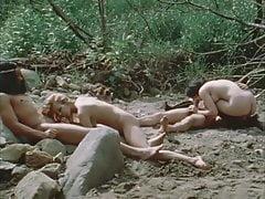 Group sex near of a lake
