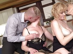 Three mature mothers sharing young son